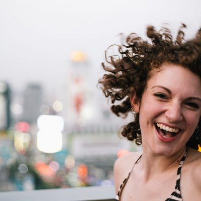 smiling woman caught in a candid shot with hair flipping