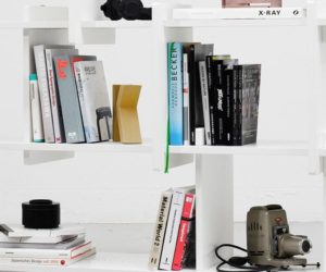 modern white bookshelves with books and other various items